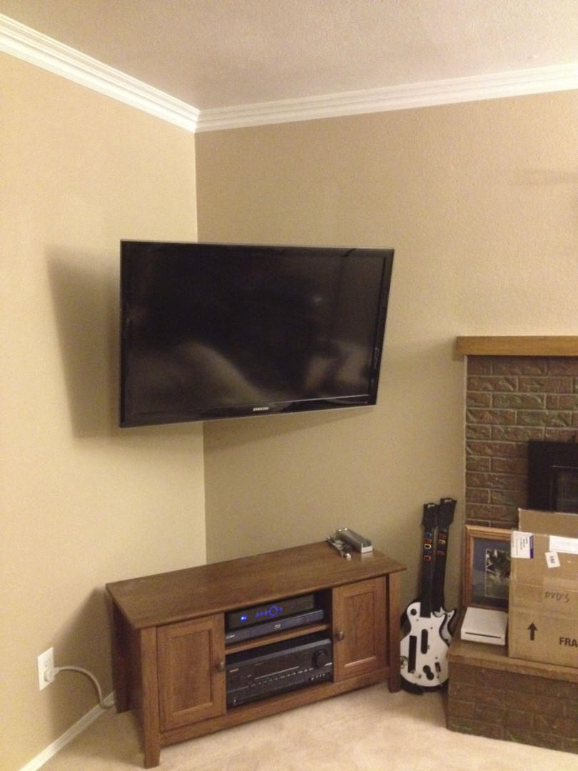 wall mounted tv in a corner of the room